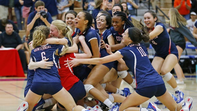 Centennial  players celebrate their win over Sunnyslope in the high school 5A Conference volleyball state championship match Wednesday, Nov. 9, 2016 in Gilbert,  Ariz.