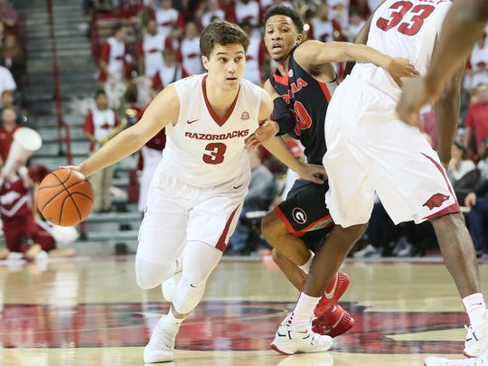 Arkansas guard Dusty Hannahs (3) dribbles the ball in the first half as Georgia guard J.J. Frazier (30) defends during a March 4 game.