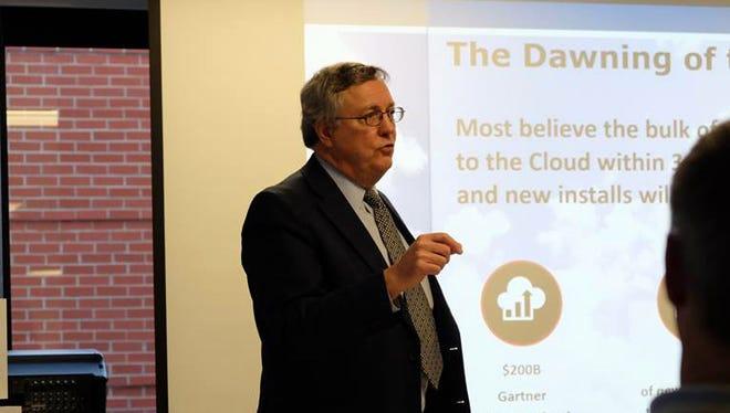 Technology consultant John Burton of Network Performance Inc. discusses cloud computing at Free Press Media in Burlington on Thursday.