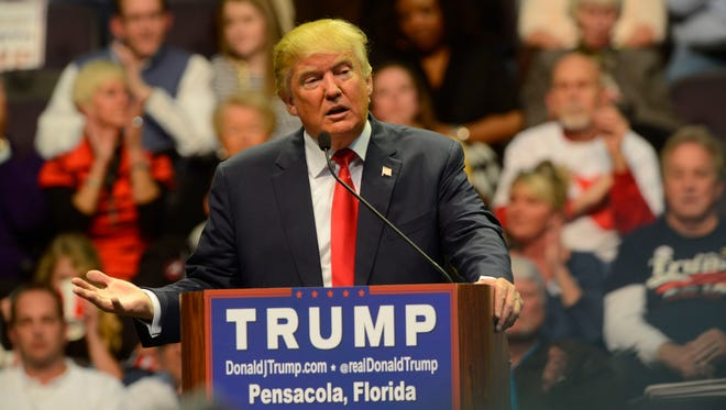 Presidential candidate Donald Trump speaks to the crowd Wednesday night at the Pensacola Bay Center.
