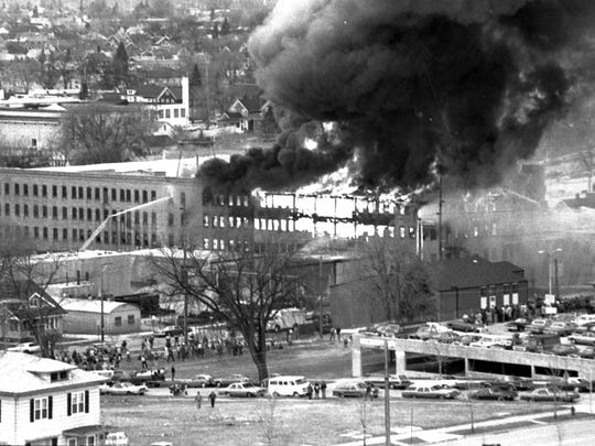 Crowds of onlookers gather to watch Thonet Industries burn on Monday, April 19, 1982.