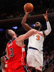 New York Knicks guard Tim Hardaway Jr. (3) puts up a shot against Washington Wizards guard Bradley Beal (3) during the fourth quarter of a preseason NBA basketball game, Friday, Oct. 13, 2017, in New York. The Wizards won 110-103.