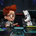 Sherman (left, voiced by Max Charles) and Mr. Peabody (voiced by Ty Burell) from the animated film 'Mr. Peabody & Sherman.' Credit: DreamWorks Animation.