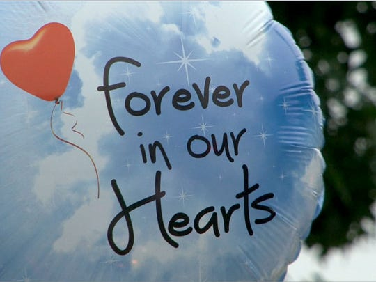 """One of the balloons that was part of a memorial in memory of AbbieGail """"Abbie"""" Smith, 11, Friday night,  July 14, 2017.  Smith was killed by a neighbor in her Keansburg apartment complex Friday,  July 14, 2017, near where the remains of 11-year-old Abbiegail 'Abby' Smith were found Thursday."""