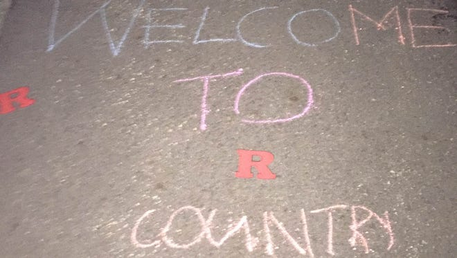 """Welcome to Rutgers Country"" written in chalk near Paramus Catholic."