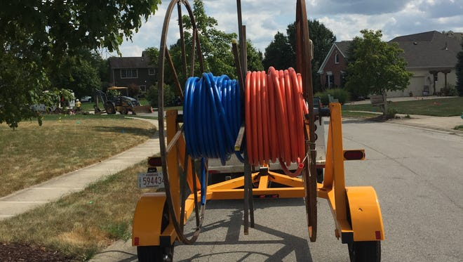 Fiber-optic cables are ready to be installed in the Windermere subdivision in Fishers.