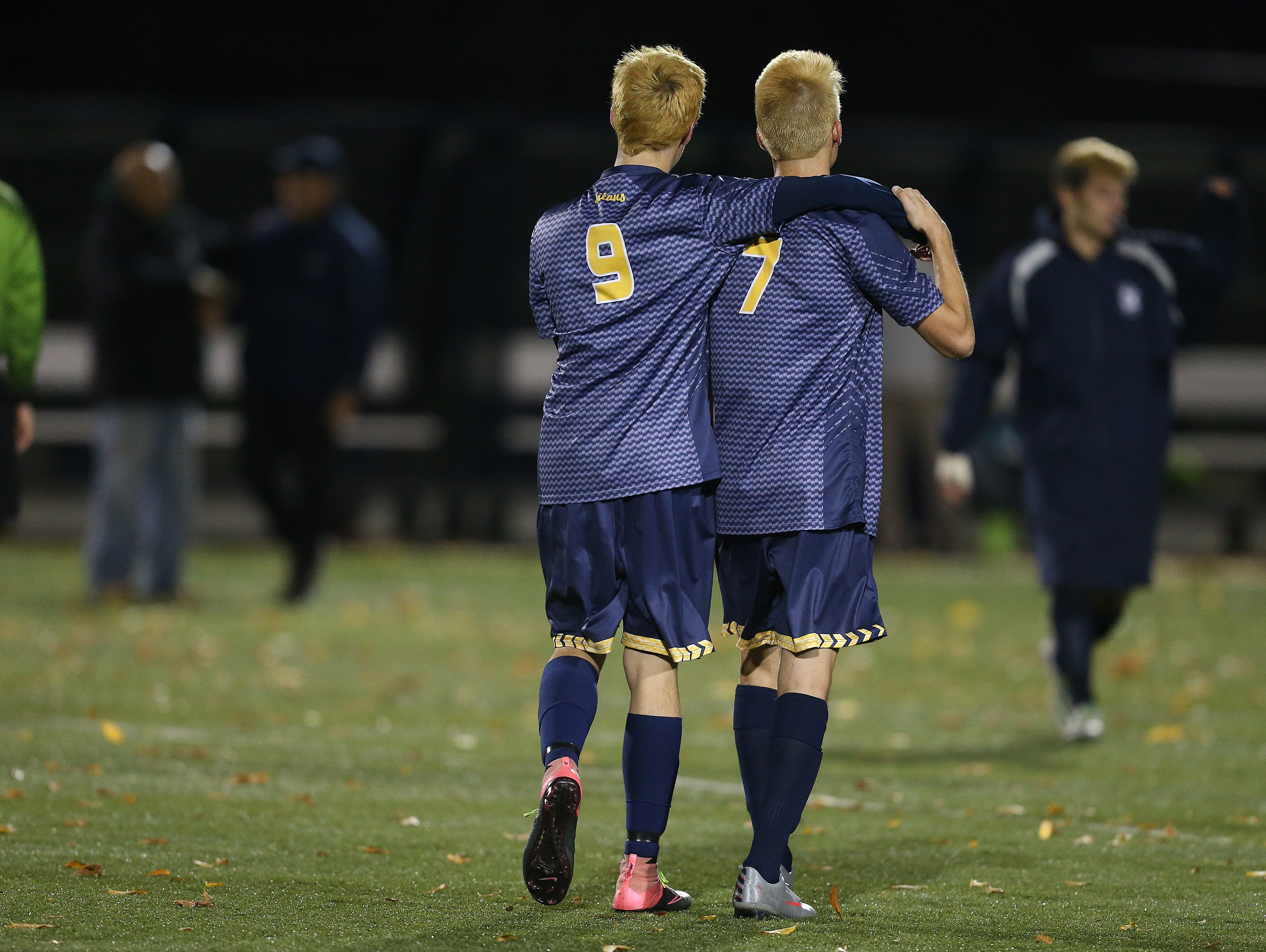 Webster Thomas' Owen Lederman (9) and Ryan Cullen walk off the field after a 2-1 loss to Fairport in the Class AA final.