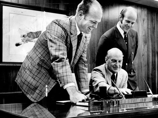 Paul Brown, center, with his sons Mike, left, and Pete