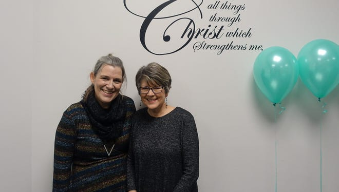From left, Kristen McGuire and Elaine Hundley at a retirement party for the Hundleys at First Presbyterian Church on Feb. 18, 2018.