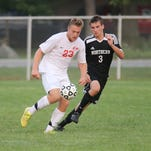 Canton's Jason Ren (No. 6) looks to get a step on a Walled Lake Northern player during Monday night's KLAA crossover varsity boys soccer matchup.