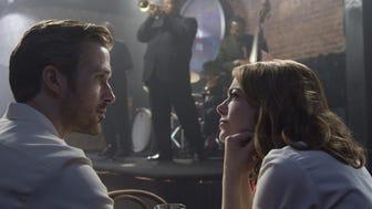 "Ryan Gosling (left) and Emma Stone star in ""La La Land."""