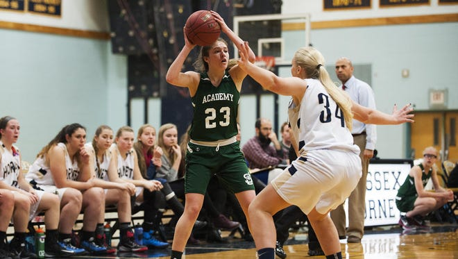 St. Johnsbury's Neva Bostic (23) looks to pass the ball during the girls basketball game between the St. Johnsbury Hilltoppers and the Essex Hornets at Essex high school on Tuesday night January 5, 2016 in Essex.