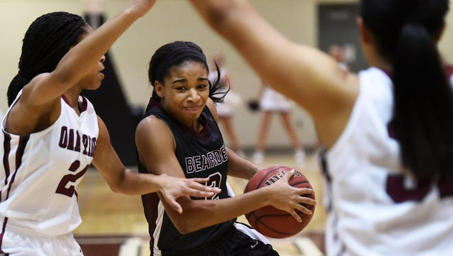 Bearden's Trinity Lee charges towards the basket while defended by Oak Ridge's Jada Guinn during a Region 2-AAA girls basketball tournament game at Oak Ridge High School between Oak Ridge and Bearden on Friday