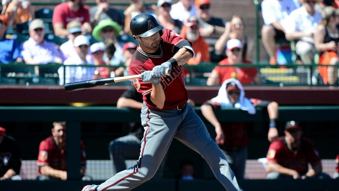 Arizona Diamondbacks center fielder A.J. Pollock (11) hits a solo home run in the first inning against the San Francisco Giants during a spring training game at Scottsdale Stadium.