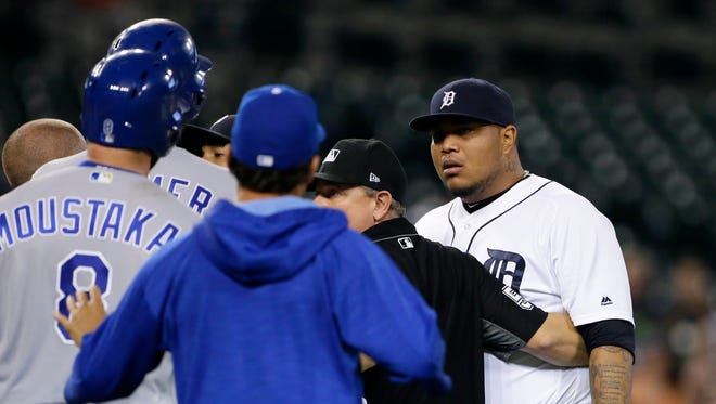 Tigers pitcher Bruce Rondon and Royals' Mike Moustakas stare down each other after Moustakas was hit by a pitch from Rondon, clearing the benches in the ninth inning at Comerica Park on July 26, 2017. Rondon was ejected from the game and the Royals defeated the Tigers, 16-2.
