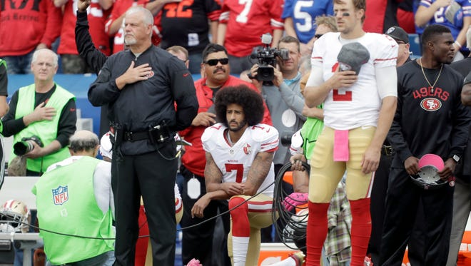 San Francisco 49ers quarterback Colin Kaepernick (7) kneels during the national anthem before an NFL football game against the Buffalo Bills on Sunday, Oct. 16, 2016, in Orchard Park, N.Y.