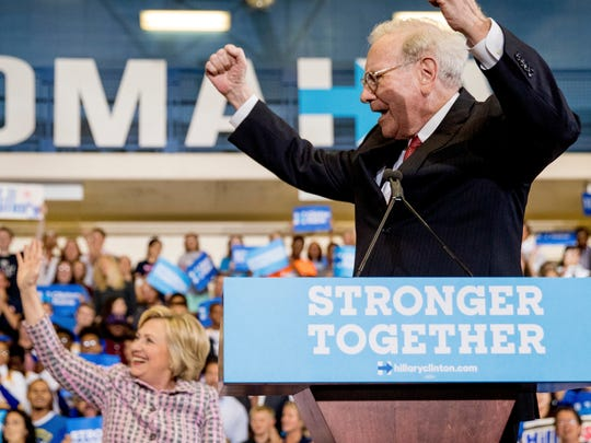 Berkshire Hathaway Chairman and CEO Warren Buffett cheers as he and Democratic presidential candidate Hillary Clinton arrive at a rally at Omaha North High Magnet School in Omaha, Neb., Monday, Aug. 1, 2016. (AP Photo/Andrew Harnik)