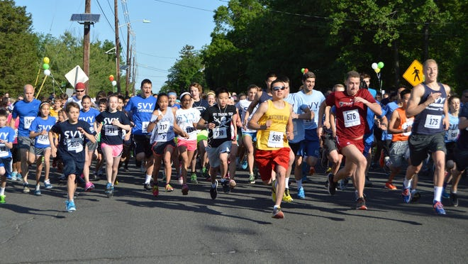 The start of Saturday's Hillsborough Hop 5K in front of the Somerset Valley YMCA on Amwell Road.