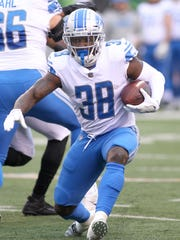 Lions RB Tion Green runs with the ball against the Bengals during the second half on Sunday, Dec. 24, 2017, in Cincinnati.