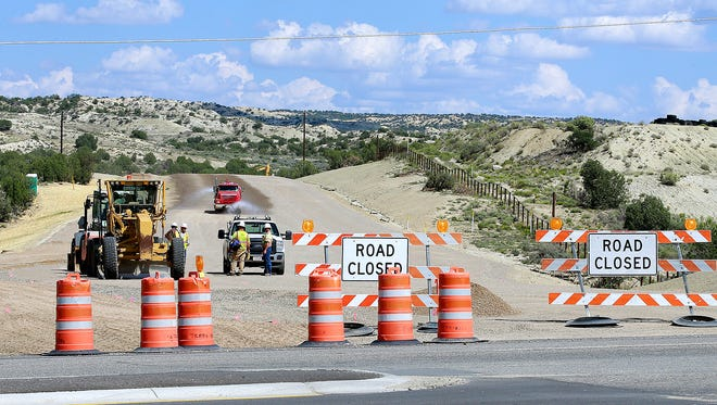 Work continues on the East Aztec Arterial Route on Friday south of Aztec, though state transportation officials announced recently that completion of the project would be delayed.