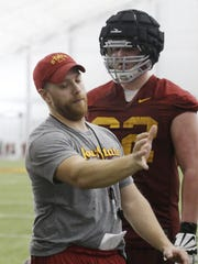 Iowa State offensive coordinator and offensive line coach Tom Manning works with the offensive line during a 2017 practice in Ames.