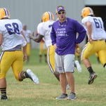 Benton head coach Reynolds Moore watches his team during a recent practice.