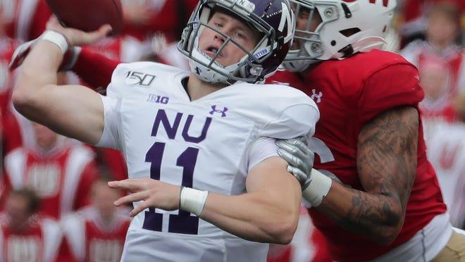 Wisconsin linebacker Zack Baun hits Northwestern quarterback Aidan Smith to force an interception returned for a touchdown.