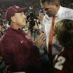 Miami coach Al Golden, right, talks to Florida State coach Jimbo Fisher before the start their 2013 game.