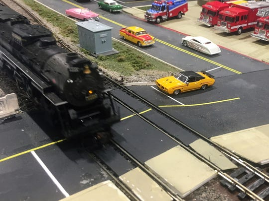 A model train moves through a mock-up of Battle Creek during the Blue Water Area Railroad Show and Swap Shop on Sunday, May 6, 2018.