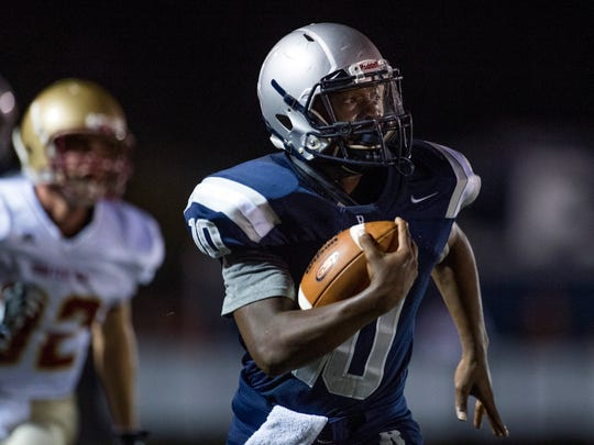Reitz's Da'Ziaun Sargent (10) carries the ball as the Mater Dei Wildcats take on the Reitz Panthers at the Reitz Bowl in Evansville, Ind., on Friday, Oct. 13, 2017.