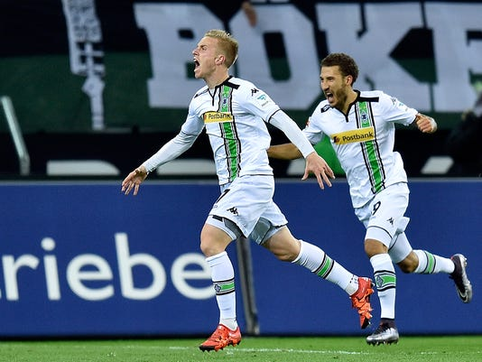 Moenchengladbach's Oscar Wendt, left, celebrates his opening goal in front of Moenchengladbach's Fabian Johnson, right, during the German Bundesliga soccer match between Borussia Moenchengladbach and Bayern Munich in Moenchengladbach, Germany, Saturday, Dec. 5, 2015. (AP Photo/Martin Meissner)