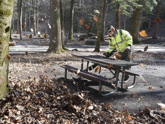 "In this file photo, Great Smoky Mountains National Park maintenance employee Tim Haynes cleans up campsites in Smokemont Campground ""D"" loop in preparation for spring. Proposed legislation would help relieve the $11.6 billion National Park maintenance backlog."