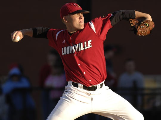 Louisville's James Belanger hurls the ball to the plate in the early innings._April 11, 2007