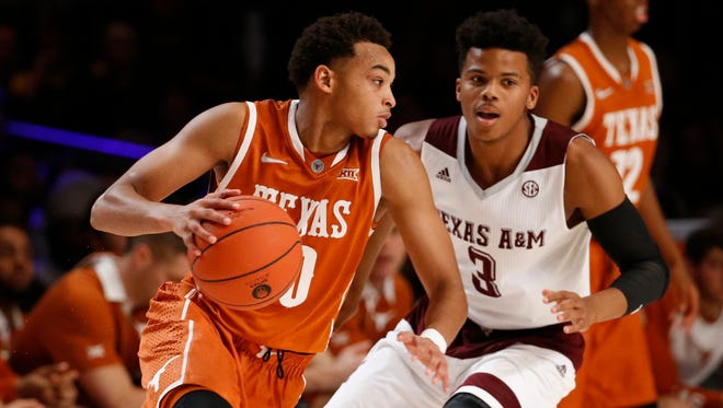 Nov 25, 2015; Texas Longhorns guard Eric Davis Jr. (10) dribbles as Texas A&M Aggies guard Admon Gilder (3) defends in the second half during the 2015 Battle 4 Atlantis in the Imperial Arena at the Atlantis Resort..