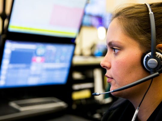 Laura Smith, 24, fields a call while working as a dispatcher at the Collier County Emergency Management building on Tuesday, April 18, 2017. A dispatcher is also known as a Public Safety Telecommunicator, or a PST.