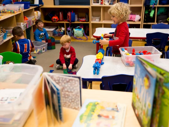 Wakefield Joyner, 5, right, plays with building blocks