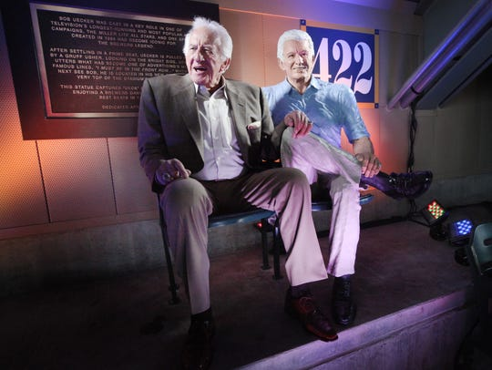 Bob Uecker jokes with photographers and well wishers