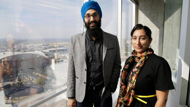 In this Dec. 11 photo, Darsh Singh, left, poses for a photo with his wife, Lakhpreet Kaur, in Dallas. It happens regularly: Someone sees a man with a turban and beard and hurls anti-Muslim slurs his way, or worse. Members of the Sikh religion, like Singh and his wife, also are feeling vulnerable as anti-Islamic sentiment heats up across the U.S., but instead of distancing themselves from Muslims, members of this southeast Asian religion are working with them to combat hateful rhetoric and dispel misconceptions about their respective faiths.