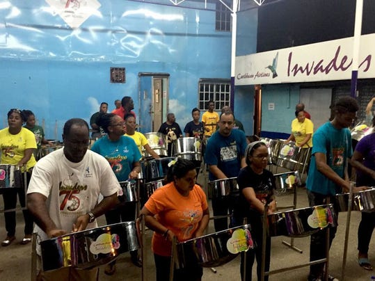 The Invaders, a steel pan band, make music in their panyard in downtown Port of Spain