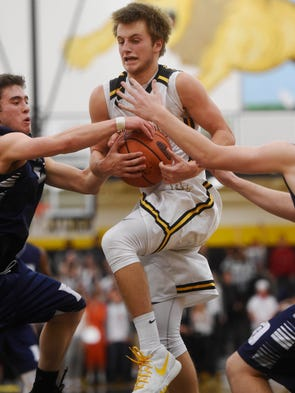 Red Lion's Bennett Frey holds on to a rebound as Dallastown's