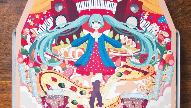 "A Japanese Domino's pizza box features Hatsune Miku, a ""singing synthesizer application with a humanioid persona."" With the aid of a free app, the character appears to perform on top of the box."