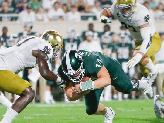 MSU QB Brian Lewerke makes it into the end zone against Notre Dame during the first quarter, making it 14-6 Notre Dame, Saturday, Sept. 23, 2017, at Spartan Stadium.