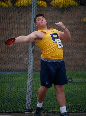 Iowa City Regina senior Jared Brinkman throws the discus during the Drake Relays on Friday, April 28, 2017, at Drake Stadium in Des Moines.