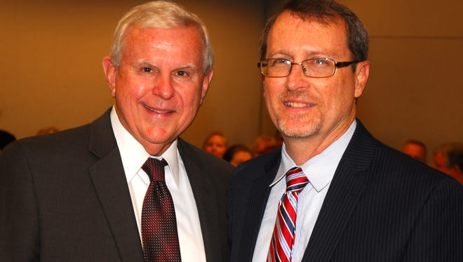 The late Norm Wolfinger poses with Phil Archer before Wolfinger swore in Archer as the new State Attorney for Brevard and Seminole County in a ceremony at the Moore Justice Center in Viera. MALCOLM DENEMARK/FLORIDA TODAY