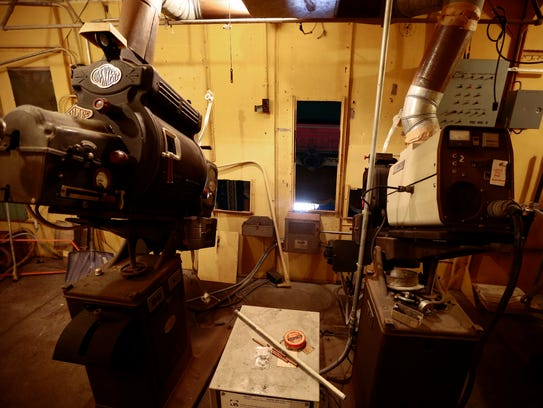 Vintage projectors are still set up in the projectionist