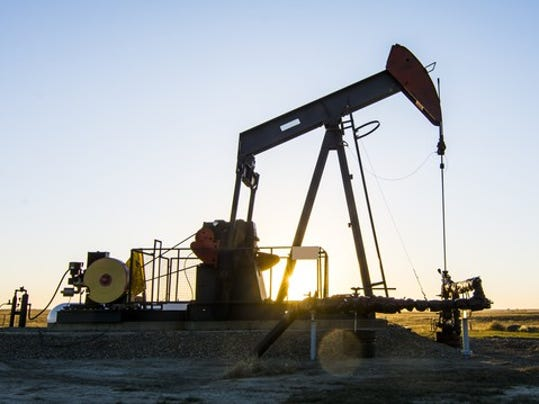 a-pump-jack-at-an-oil-well-in-southern-alberta_large.jpg