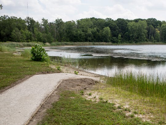 A path for a new kayak launch is being installed Thursday, August 11, 2016 at William P. Thompson Pond in Port Huron Township. A new kayak launch will be installed next week.