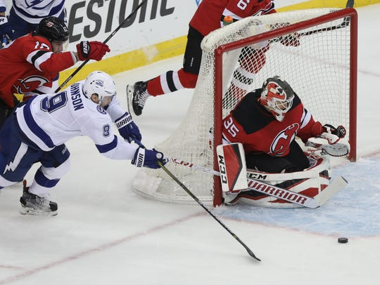 Tyler Johnson of Tampa Bay gets the puck in front of