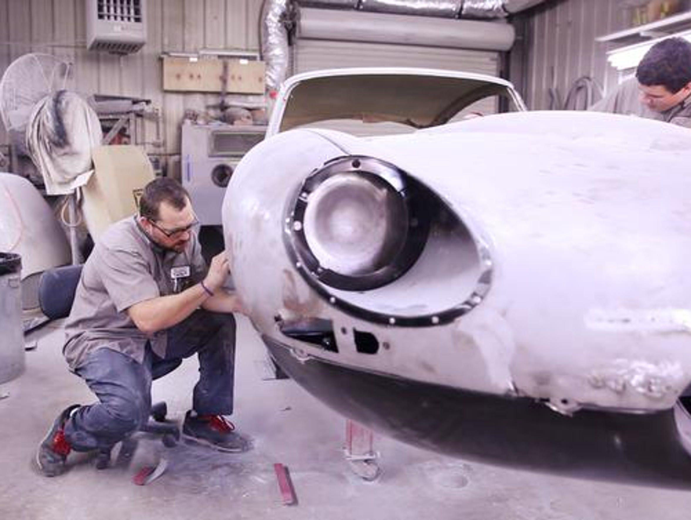 Auto body technicians Johnny Simonetti, left, of Staunton,