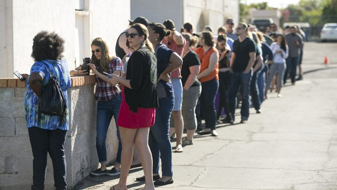 People wait in line to vote in the Arizona Primary at the polling place at Memorial Presbyterian Church at 40th Street and Thomas Road in Phoenix on Tuesday, March 22, 2016. People said they had to wait in line an hour and a half to vote.